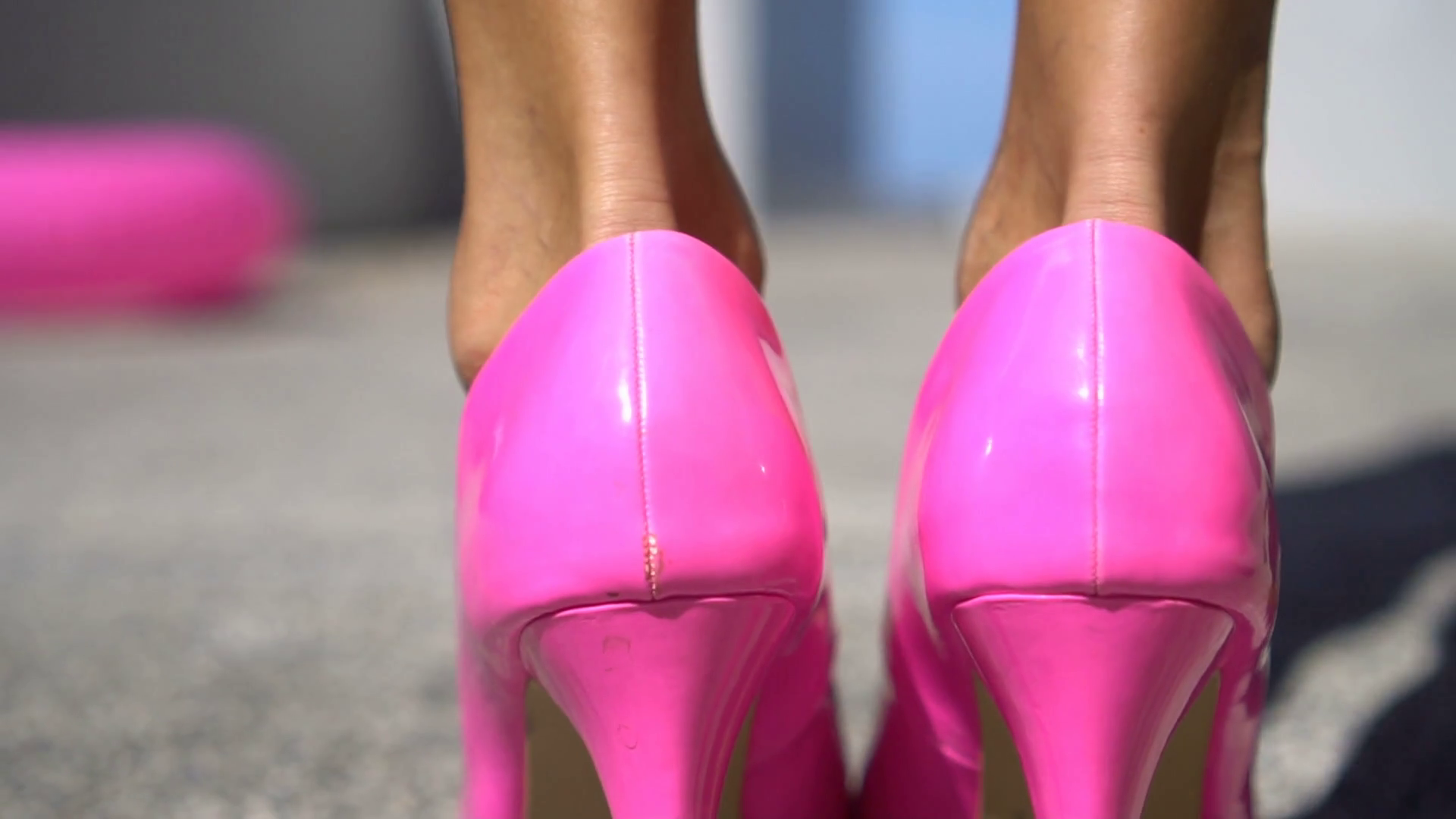 https://www.videoblocks.com/video/closeup-back-view-of-female-legs-walking-in-bright-pink-high-heels---video-in-slow-motion-hx4tlaufgizehg7t0